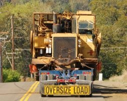 An oversize load on a flatbed trailer